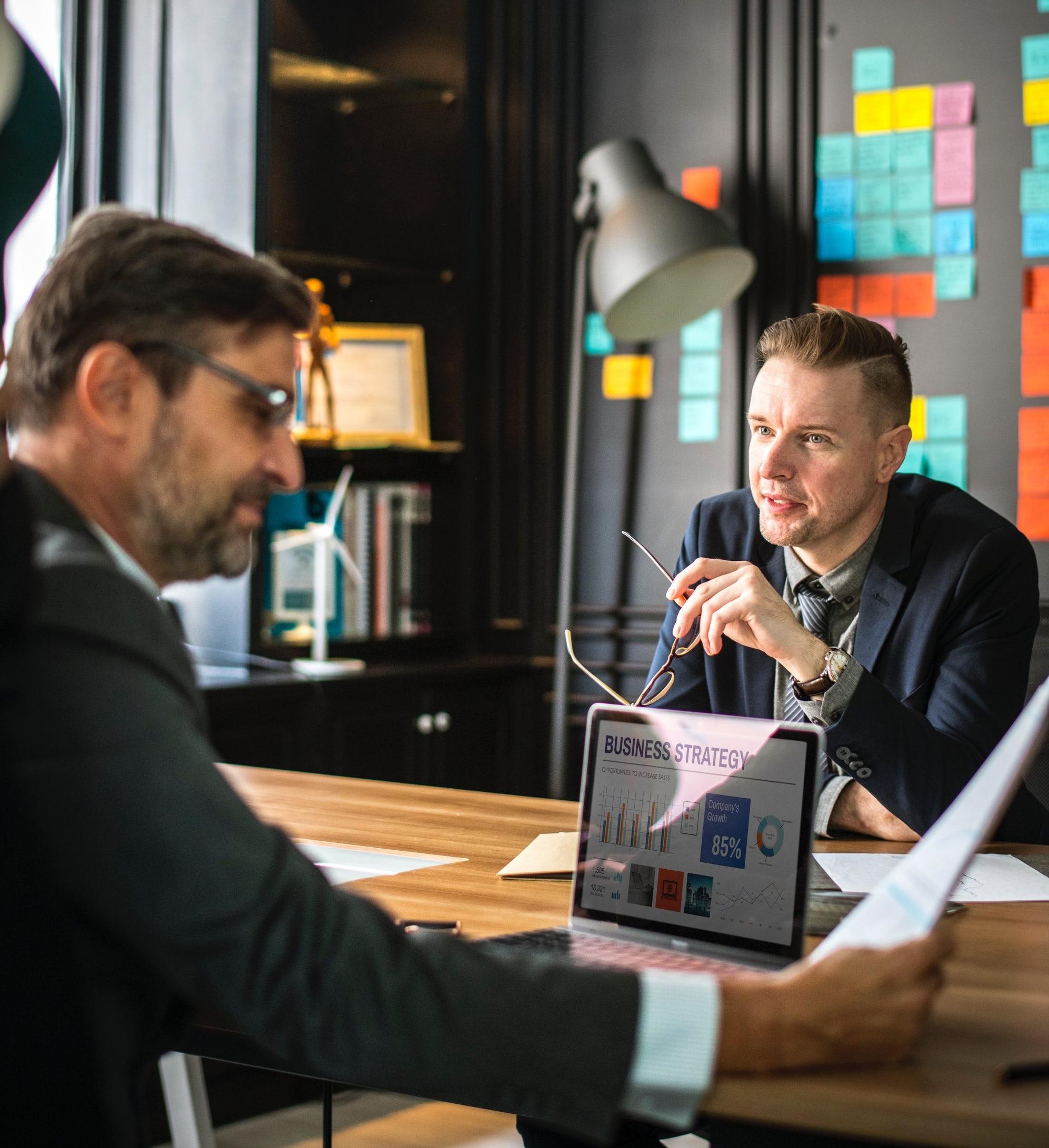 Analyzing-Brainstorming-Businessmen